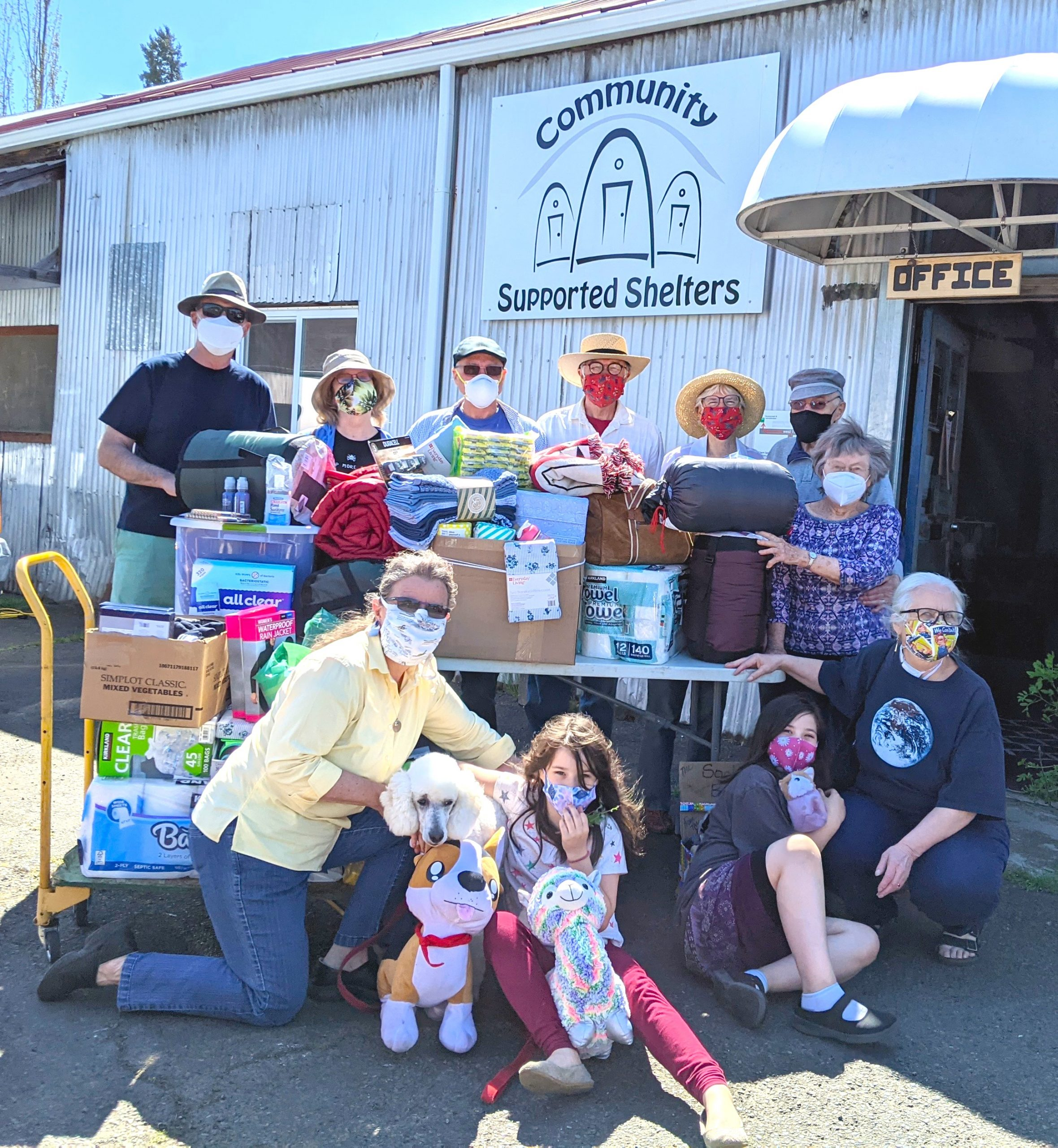 A family donating needed survival gear for the residents of Community Supported Shelters